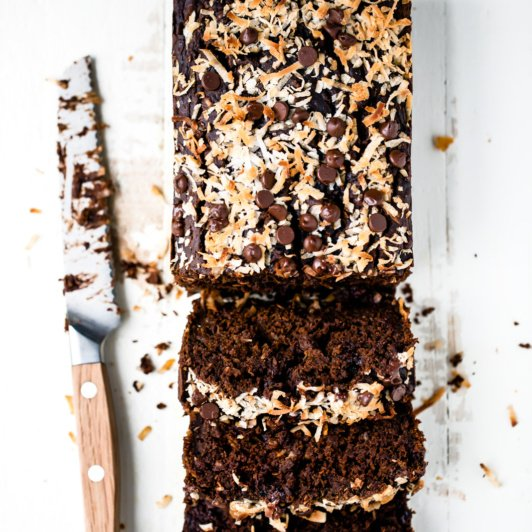 double chocolate pumpkin bread sliced next to a knife
