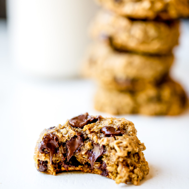 Whole grain pumpkin oatmeal chocolate chip cookies packed with cozy pumpkin flavor + plenty of chocolate chips. Made with coconut oil instead of butter!