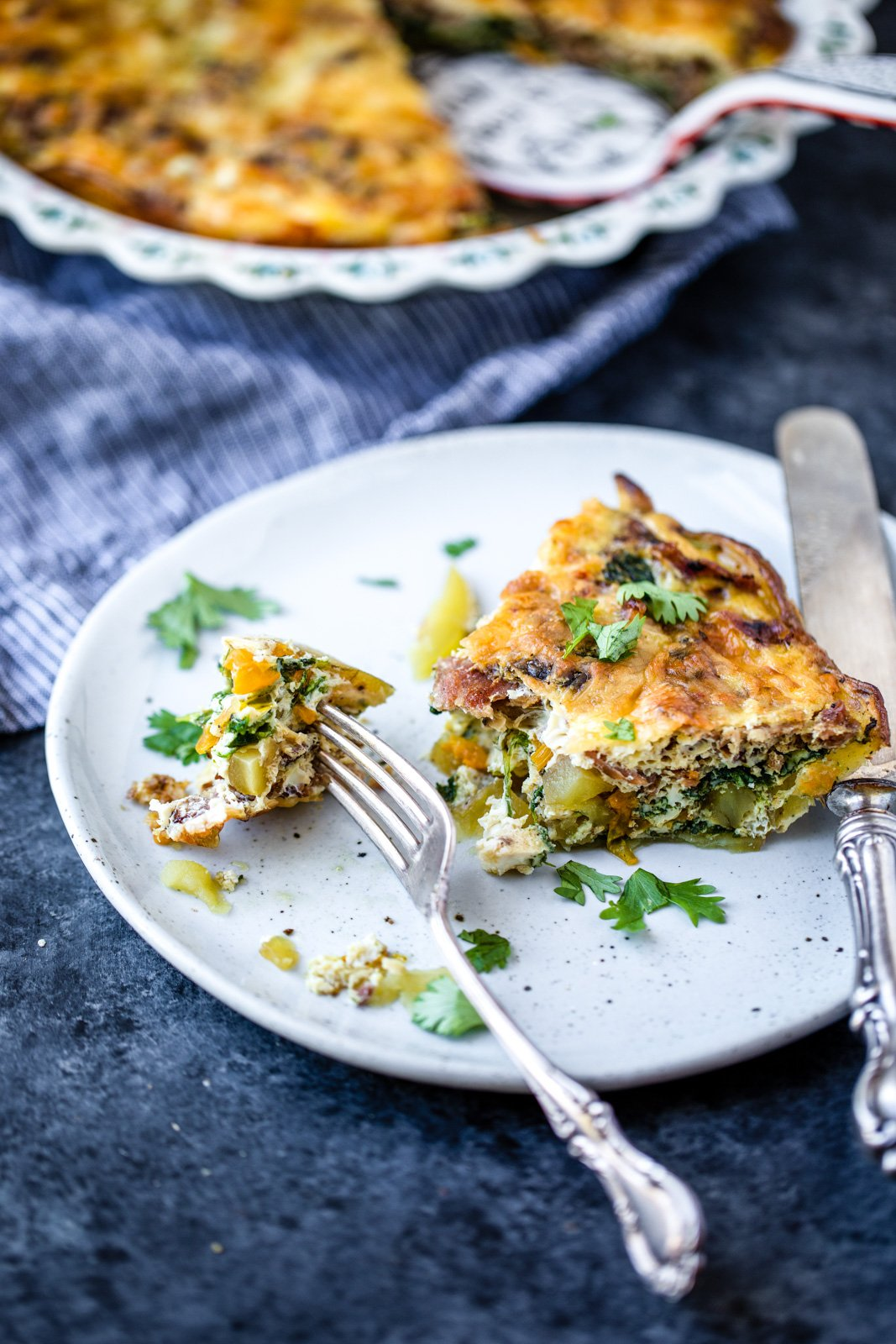 easy turkey bacon quiche on a plate with a fork
