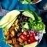 black bean sweet potato taco bowl topped with avocado
