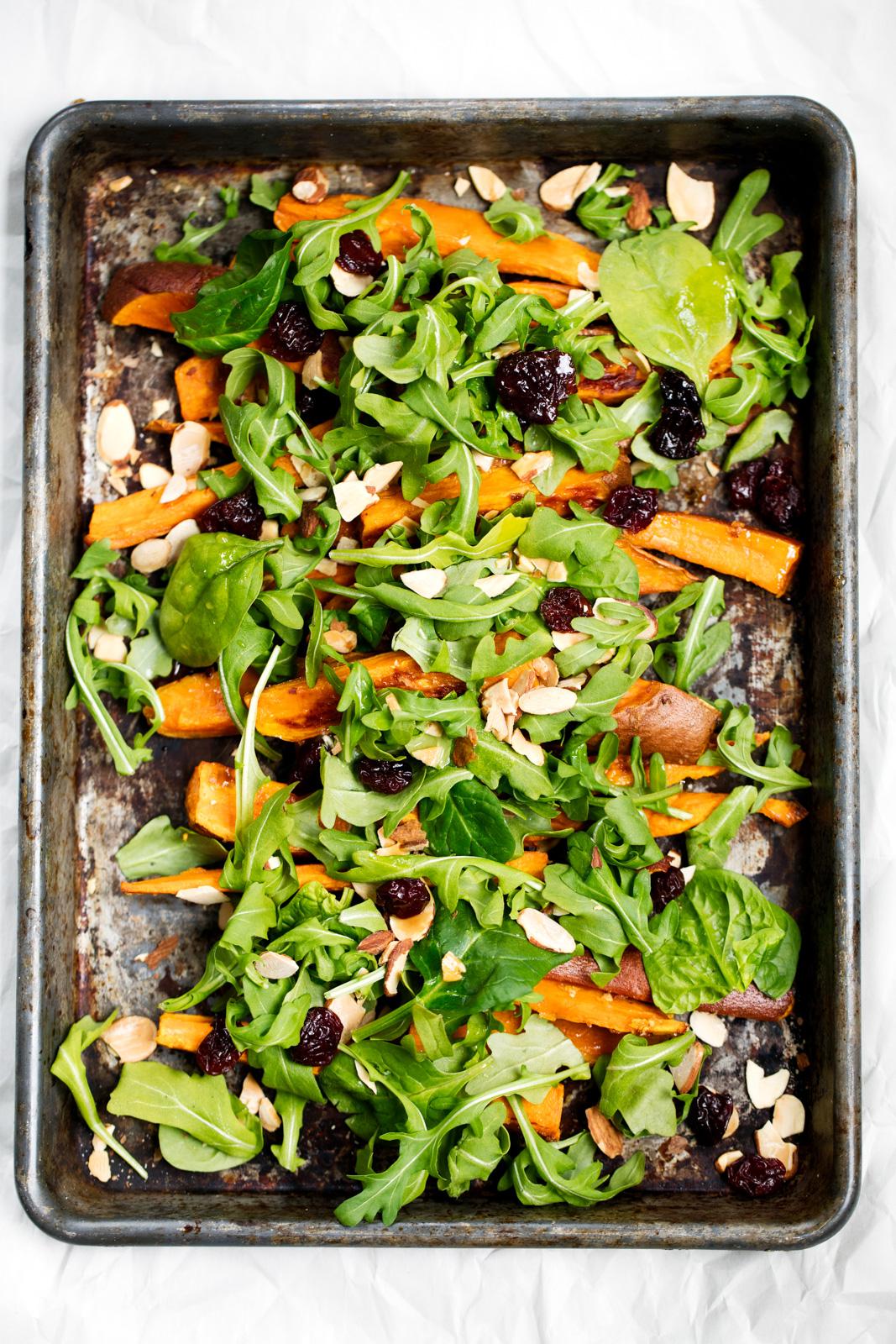 sweet potato arugula salad on a baking sheet