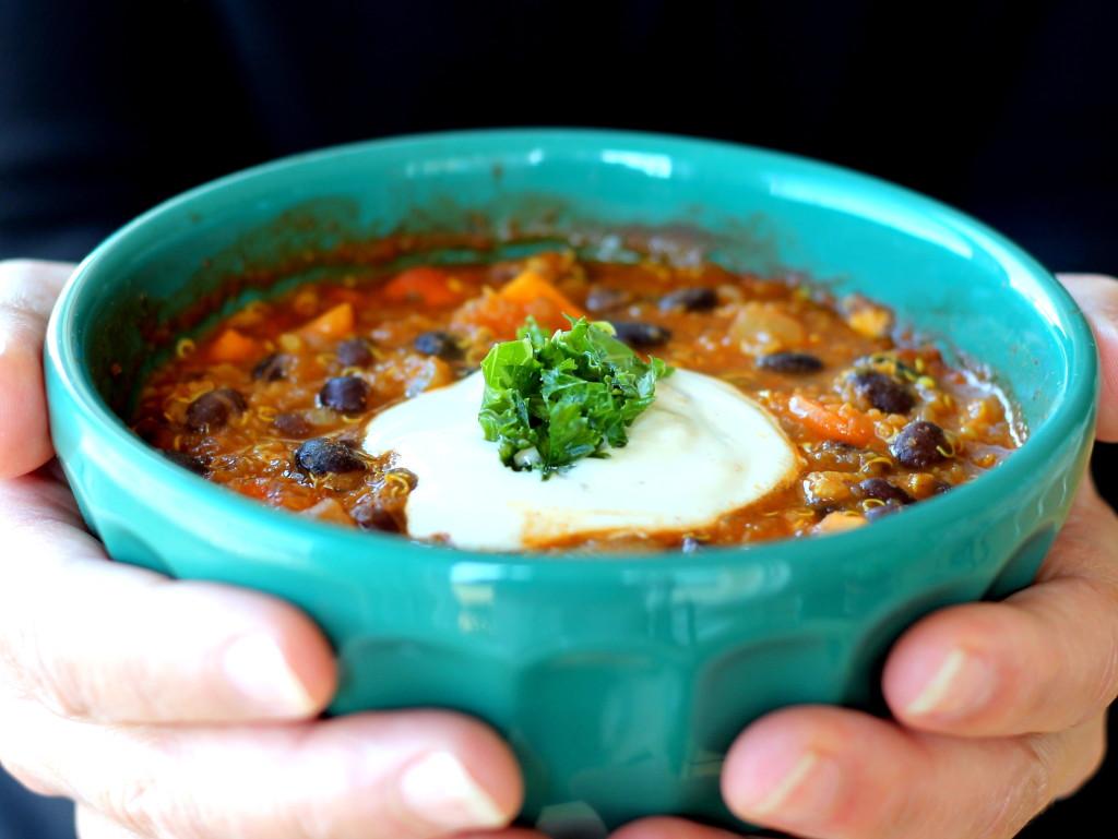 bowl of sweet potato black bean chili topped with sour cream