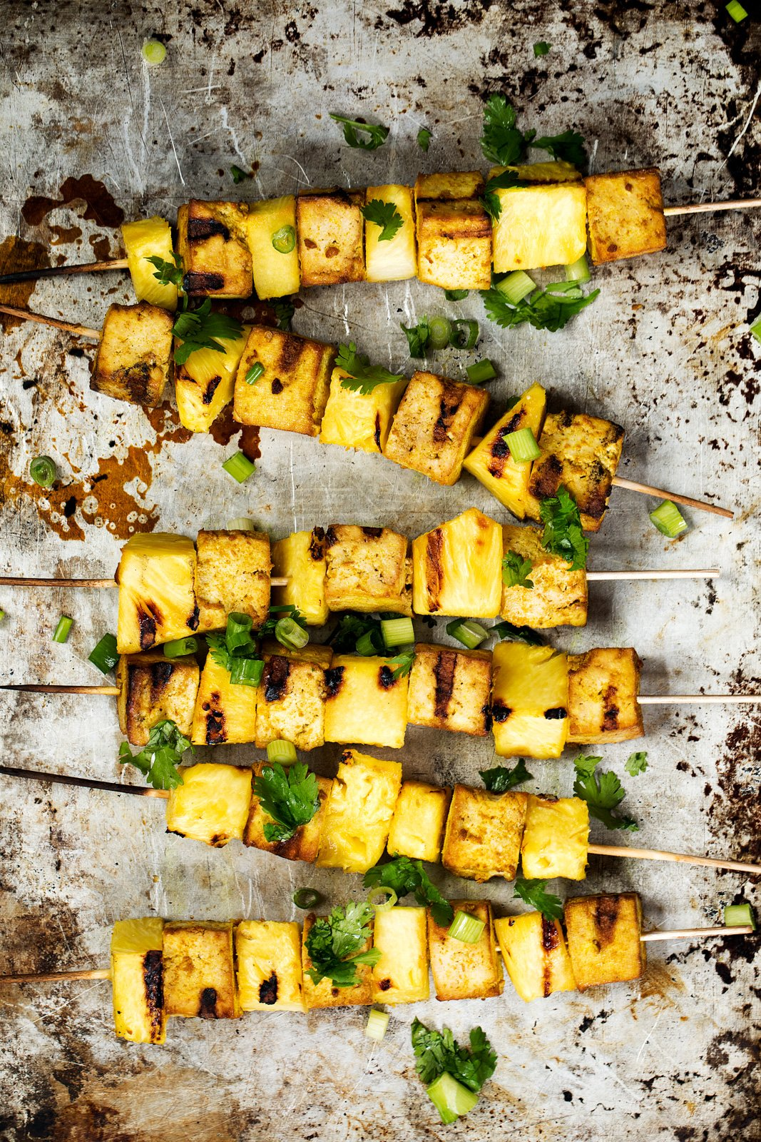 tofu and pineapple kabobs on a baking tray