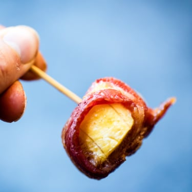 Bacon wrapped plantain on a toothpick