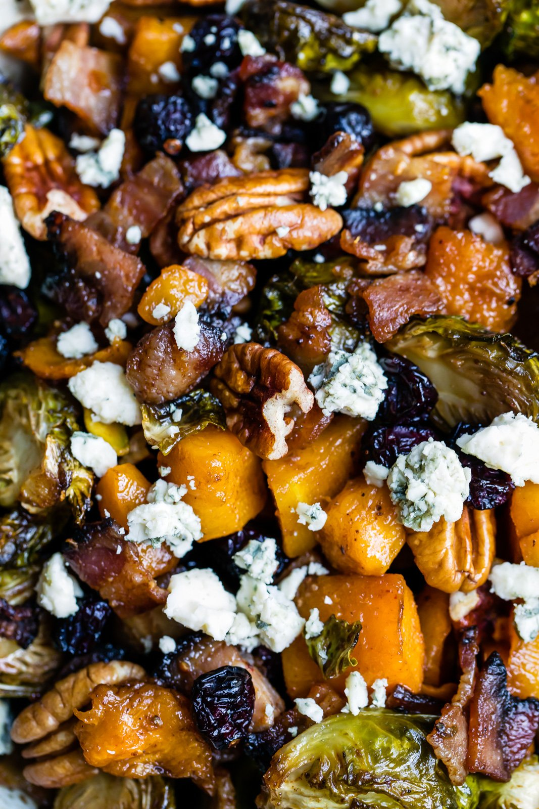 butternut squash brussels sprouts recipe with pecan and cheese in a bowl
