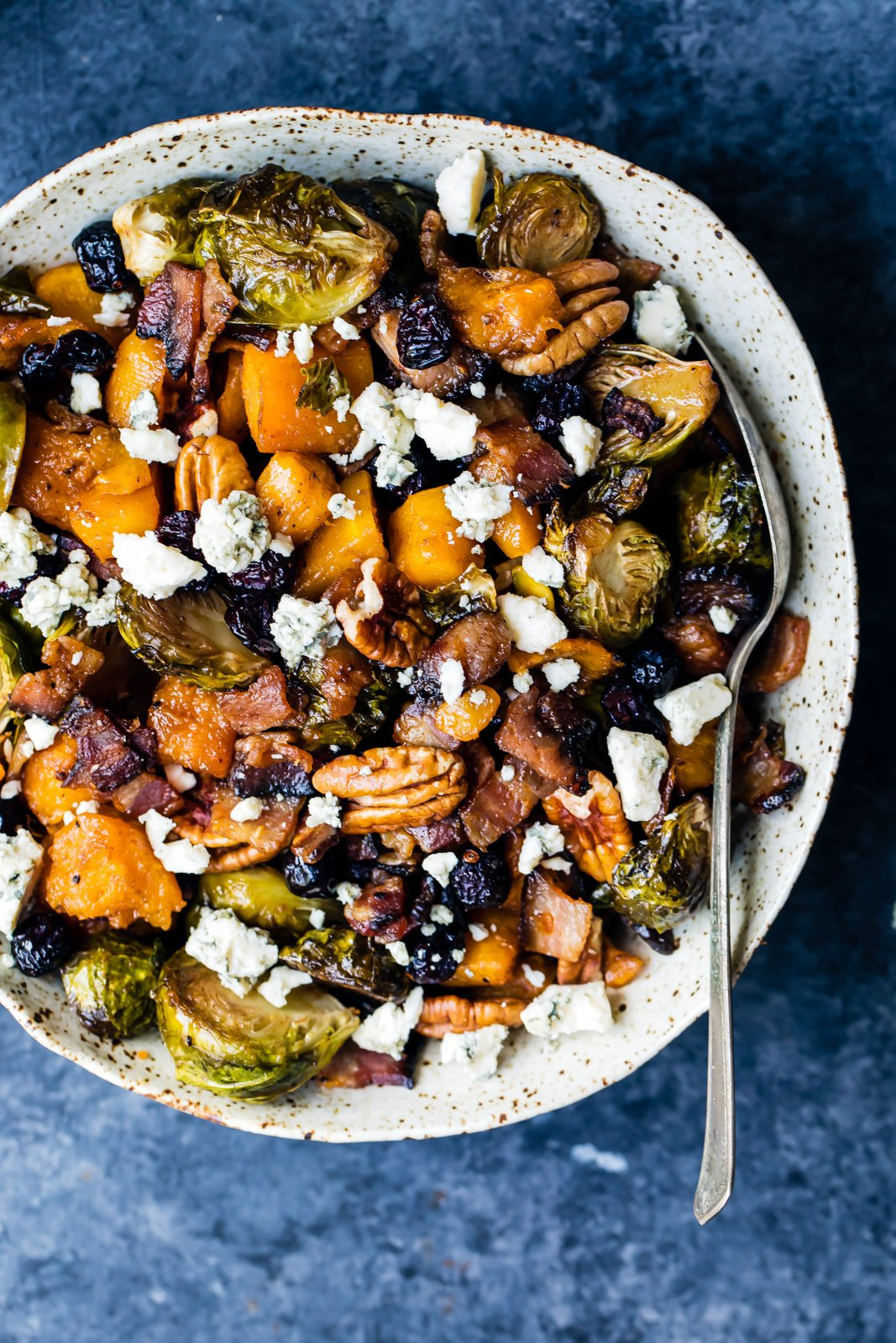 Sweet and spicy maple roasted butternut squash with brussels sprouts and savory, crispy bacon. This filling, veggie-packed dish is perfect for a side dish or a main meal!