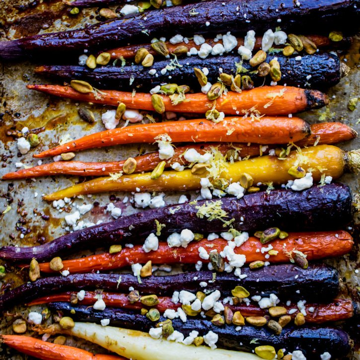 Delicious maple glazed carrots roasted with pure maple syrup and garlic. Topped with creamy goat cheese crumbles and crunchy pistachios -- this easy, veggie side dish will impress everyone at your holiday gatherings!