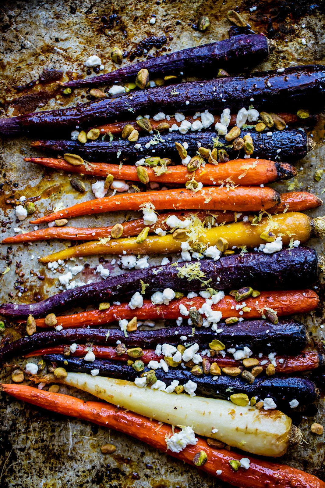 maple glazed carrots on a baking sheet
