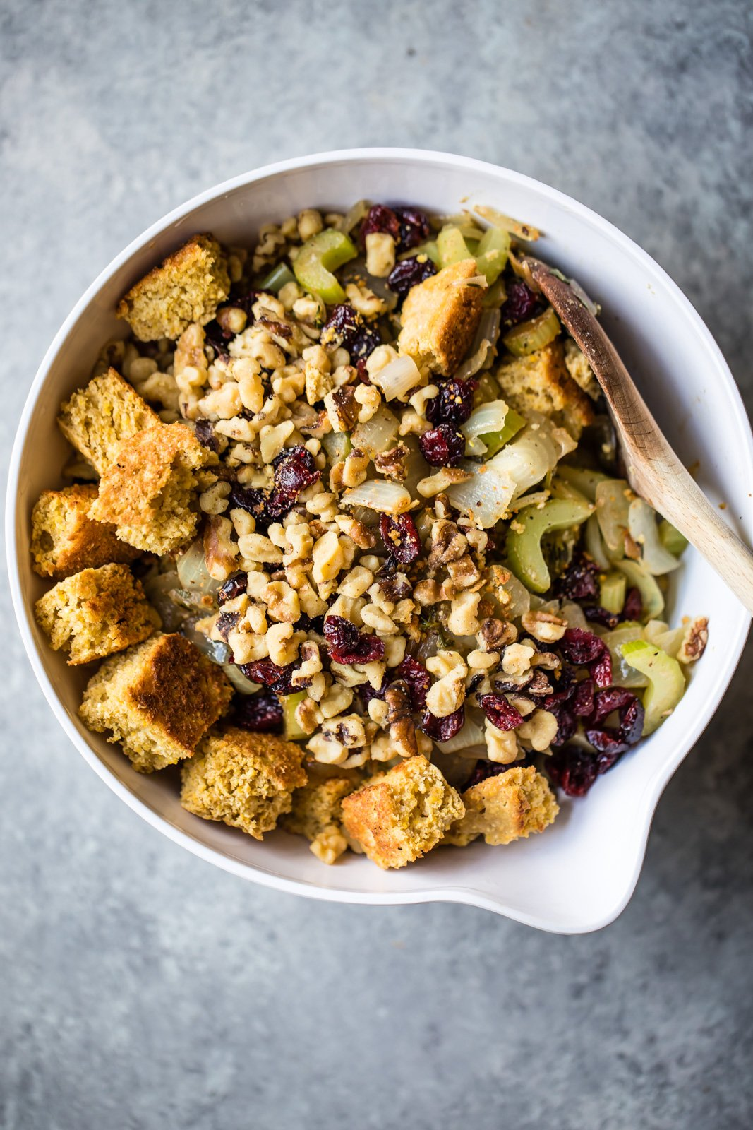 A lightened-up, gluten free take on a Thanksgiving classic! This cornbread stuffing has bites of sweetness from dried cranberries and incredible flavors from thyme and sage.