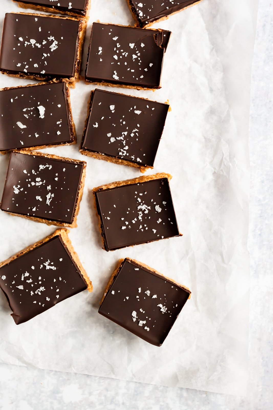 peanut butter protein bars topped with chocolate and sea salt