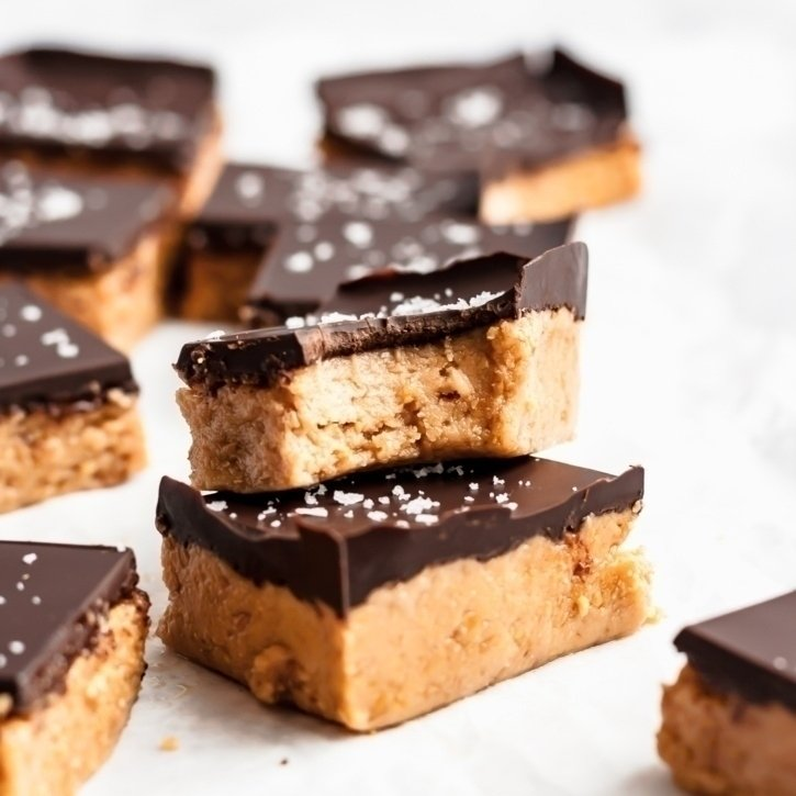 two chocolate peanut butter protein bars in a stack