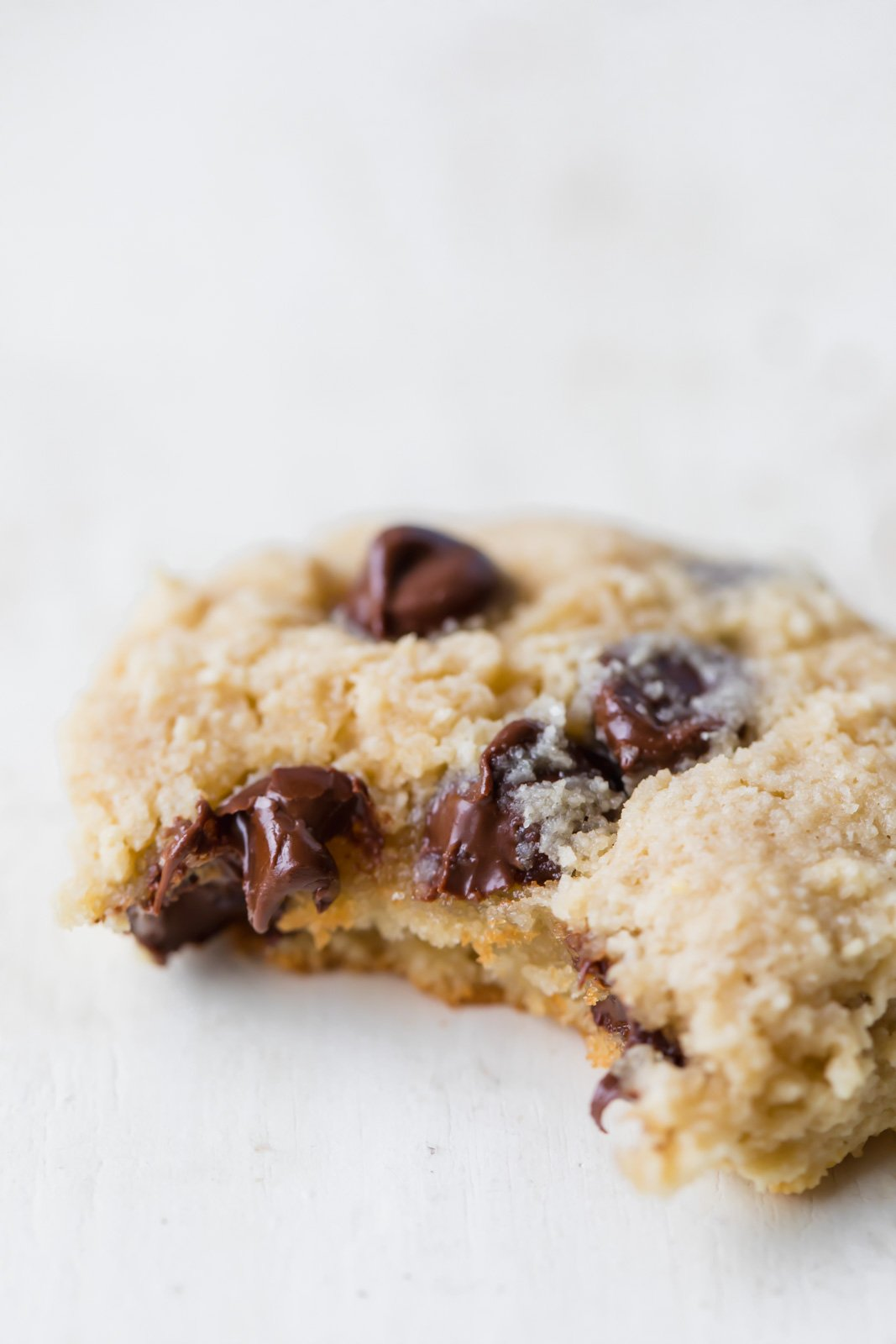 paleo almond flour chocolate chip cookie with a bite taken out