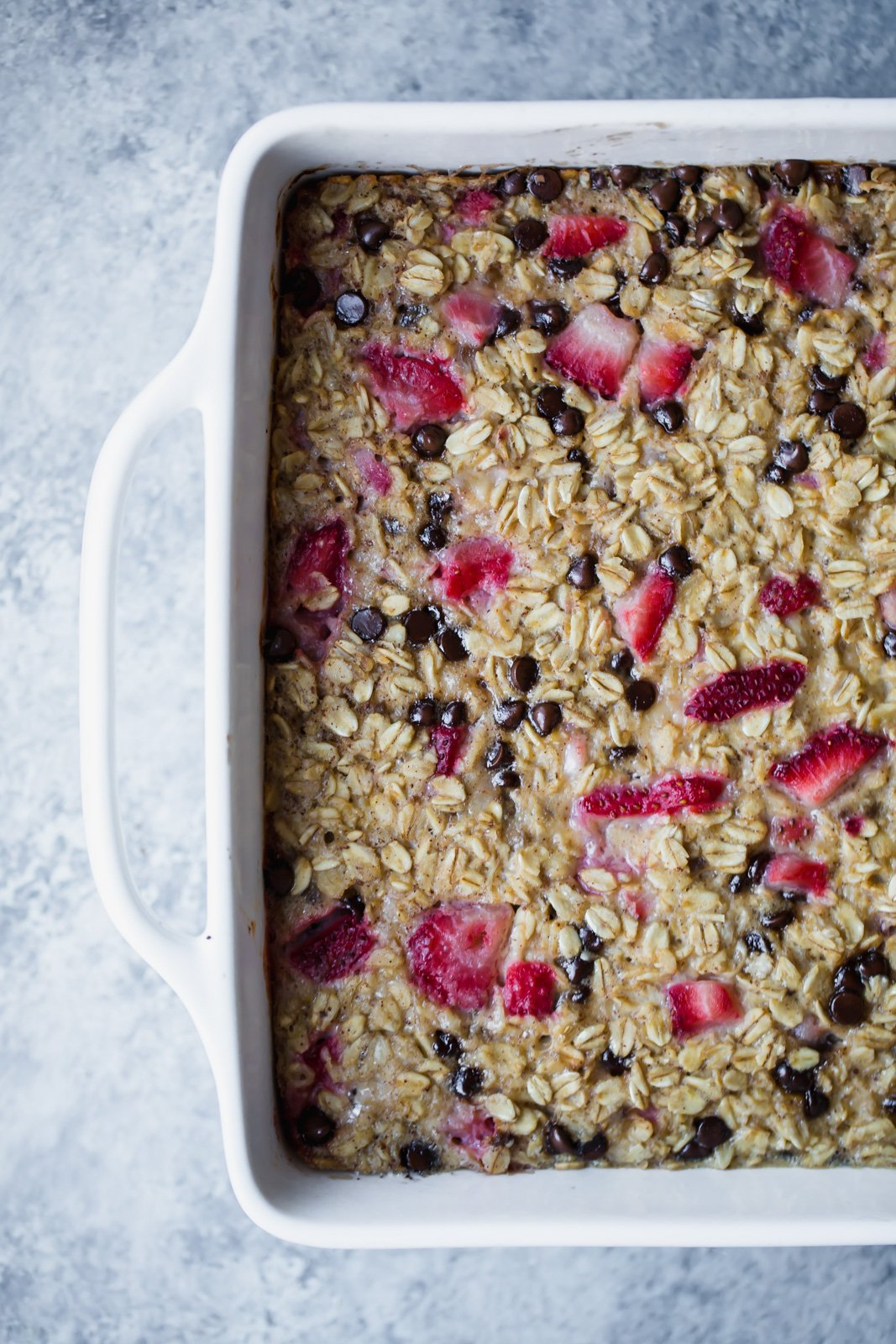 Healthy Baked Oatmeal with banana, strawberries and chocolate chips -- great for serving during the holidays or to meal prep for breakfast throughout the week. Simply reheat and enjoy! Recipe made in partnership with Almond Breeze almondmilk.