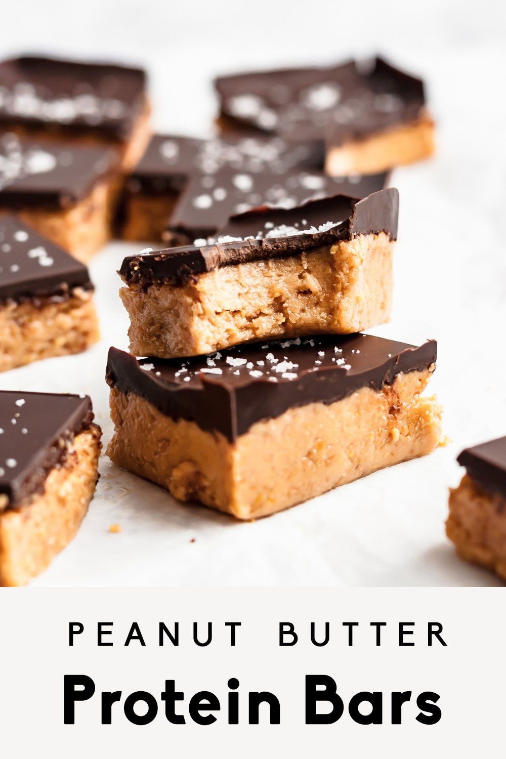 peanut butter protein bars topped with chocolate and with text overlay