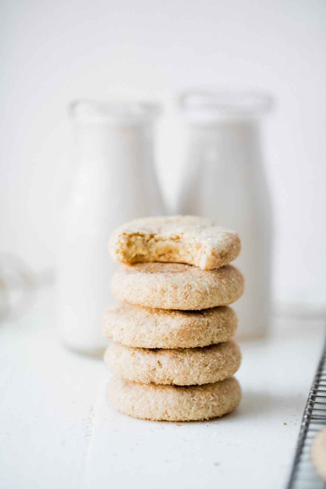 grain free snickerdoodles in a stack with milk jars in the background