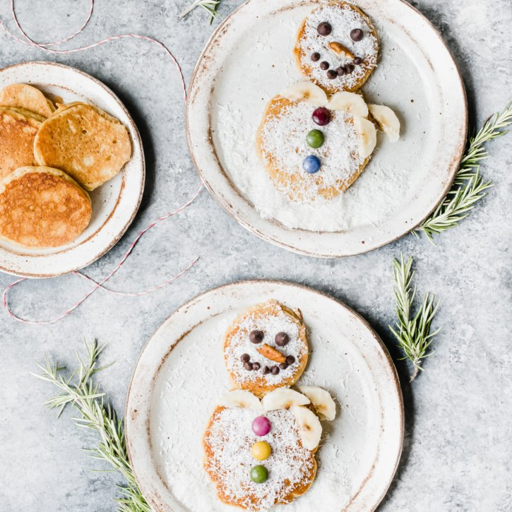 snowman pancakes on two plates