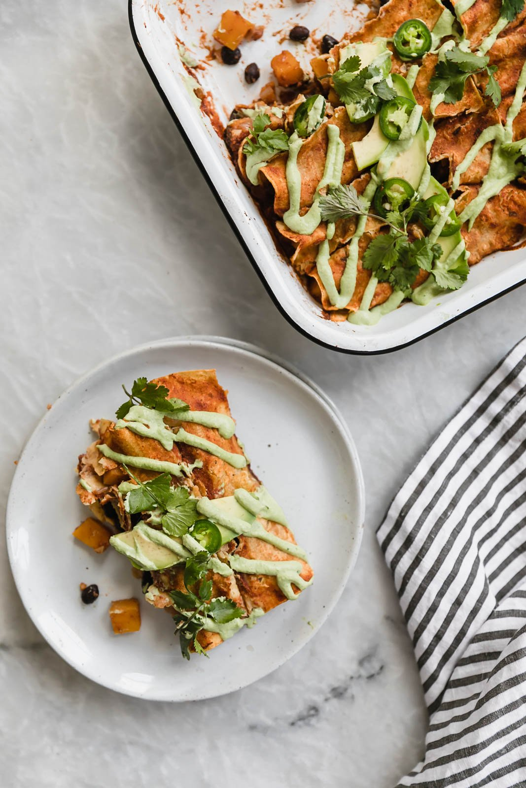 vegan enchiladas in a baking dish and on a plate