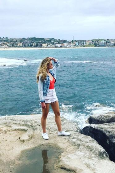 monique on rocks overlooking the ocean