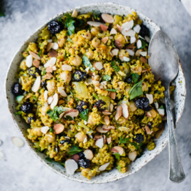healthy quinoa salad recipes: moroccan quinoa salad in a bowl with a spoon