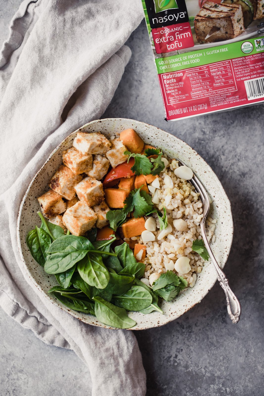 Vegan tofu bowls with spinach and rice