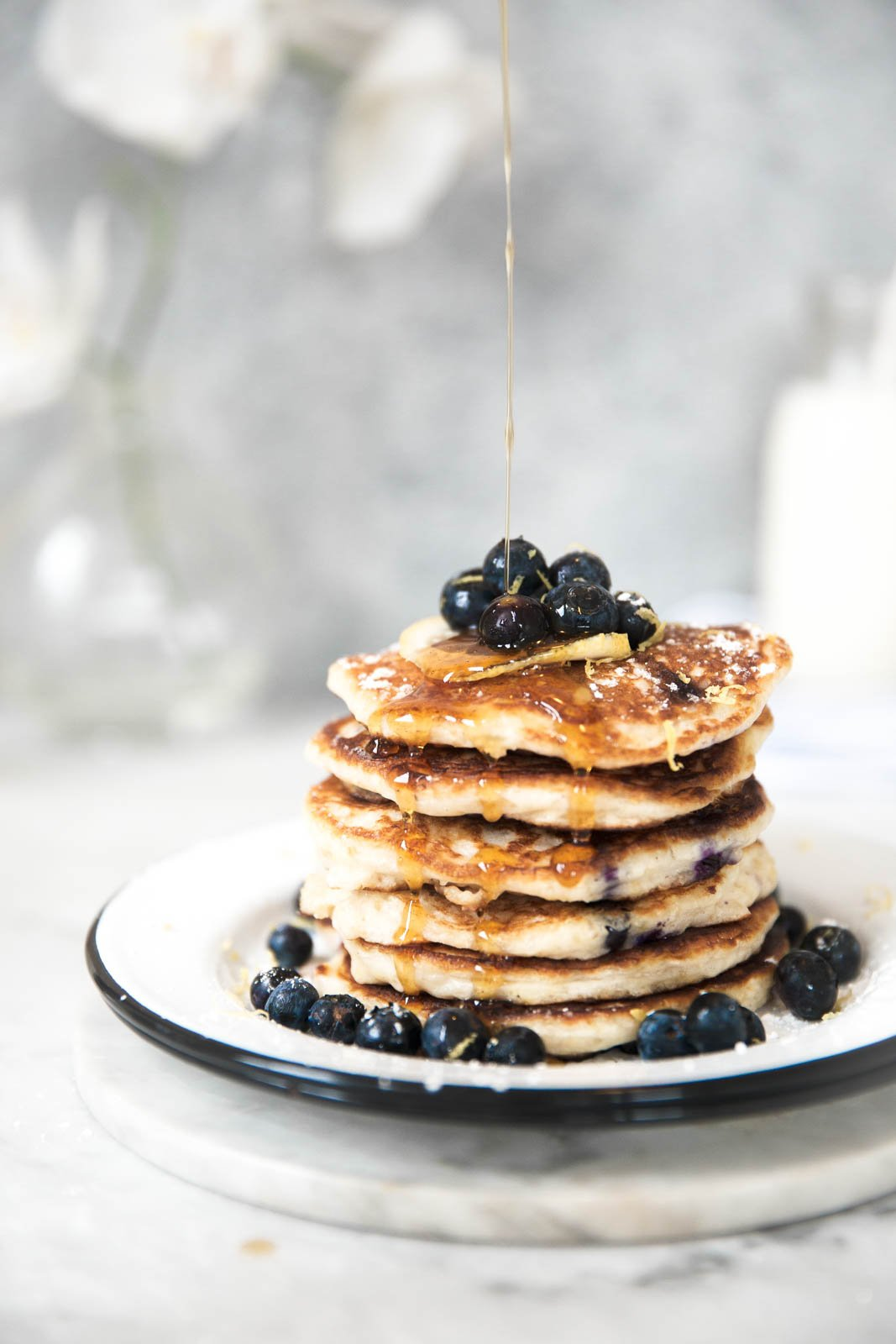 lemon blueberry quinoa pancakes with blueberries in a stack