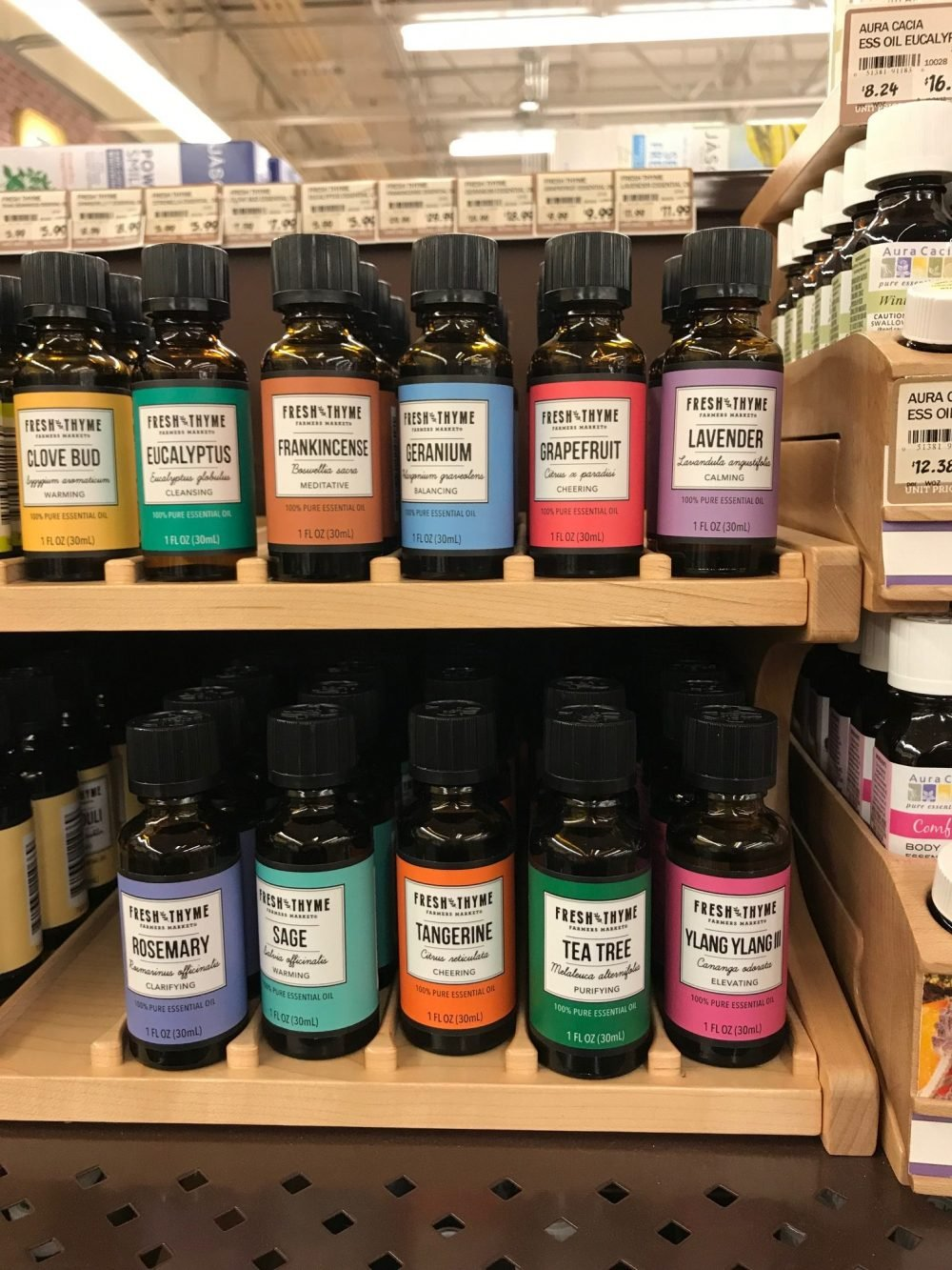 Small bottles of essential oils lined up next to each other