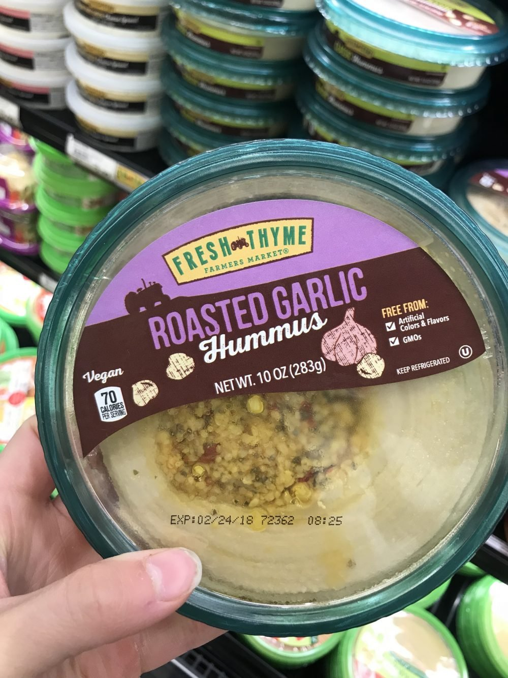 Clear tub of roasted garlic hummus