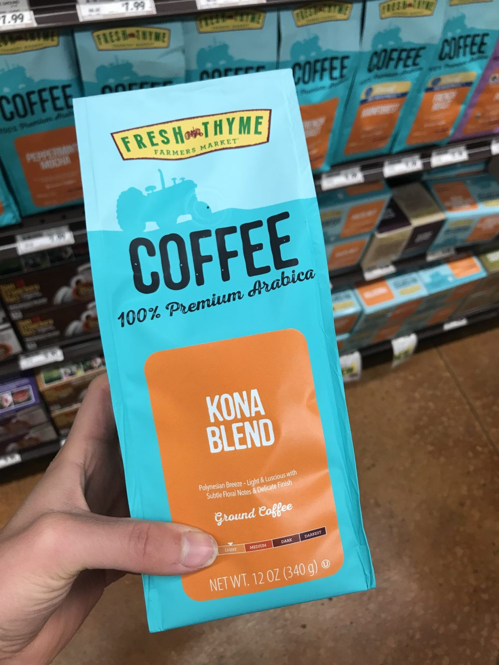 Light blue package of ground coffee