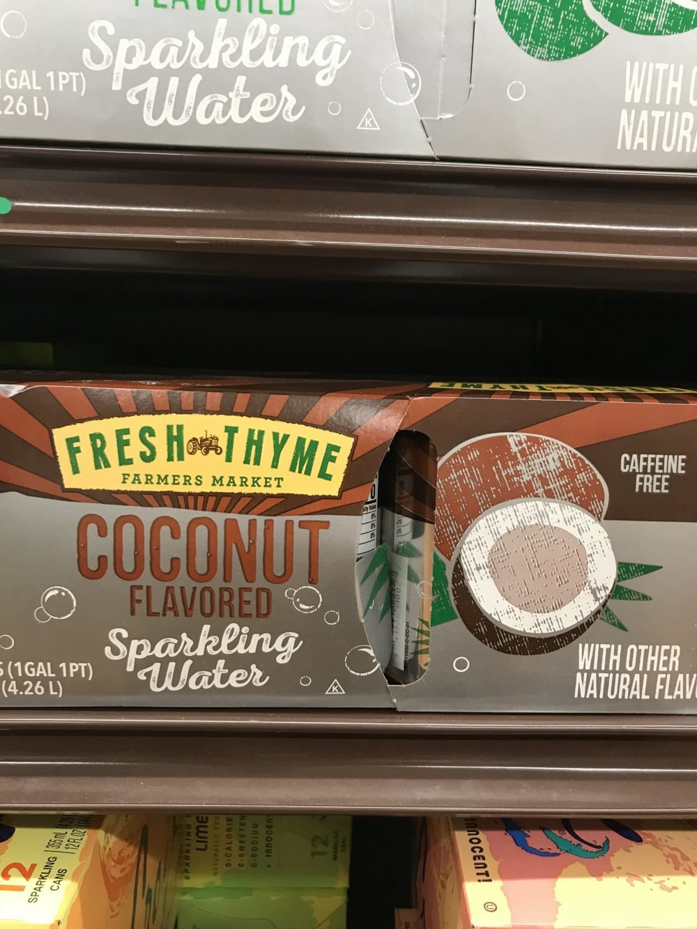Case of coconut flavored sparkling water cans