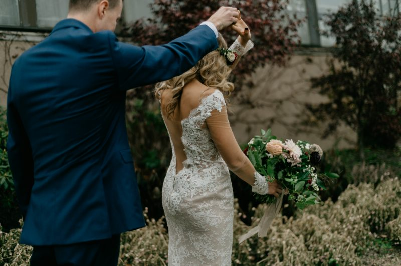 man twirling a woman in a wedding dress