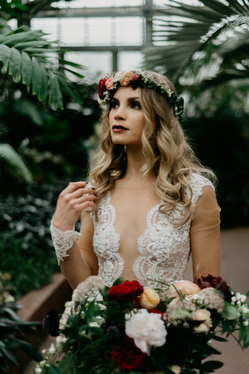 bride with a bouquet and flower crown