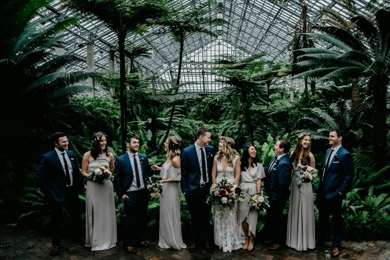 bridal party in a greenhouse
