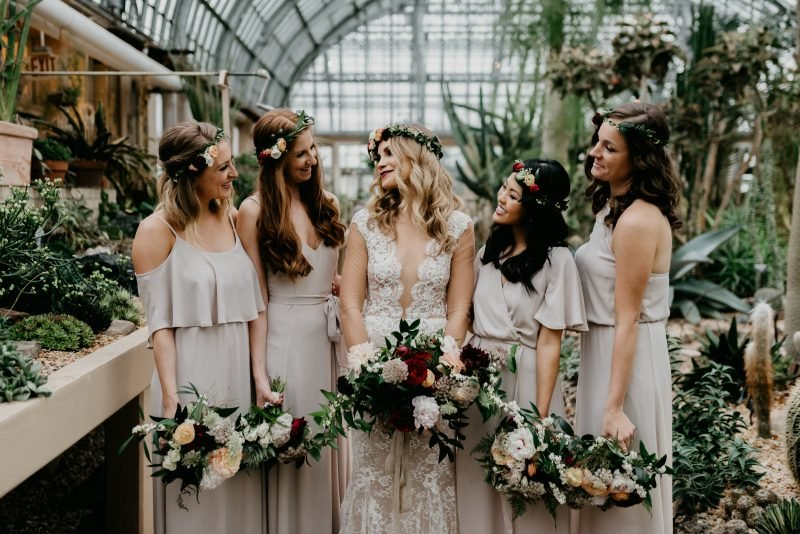 bride with four bridesmaids in a greenhouse