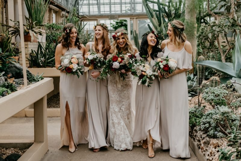 bride laughing with four bridesmaids