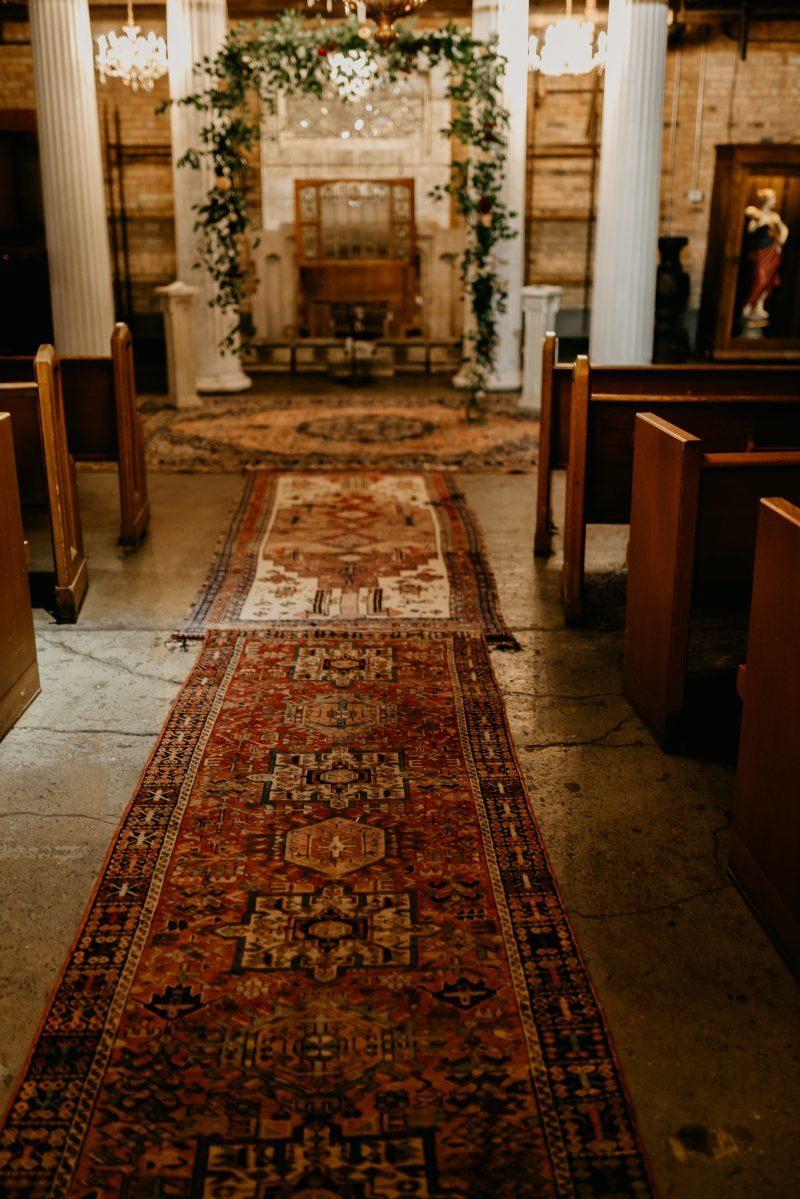 wedding aisle of vintage rugs