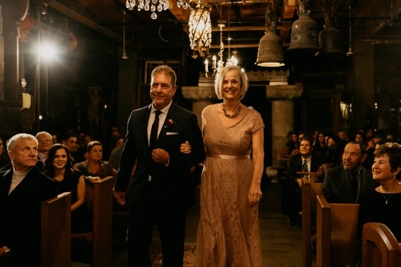 groom's parents walking down the aisle
