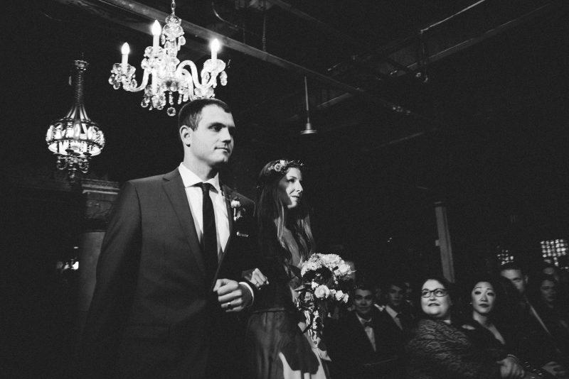 bridesmaid and groomsman walking down the aisle
