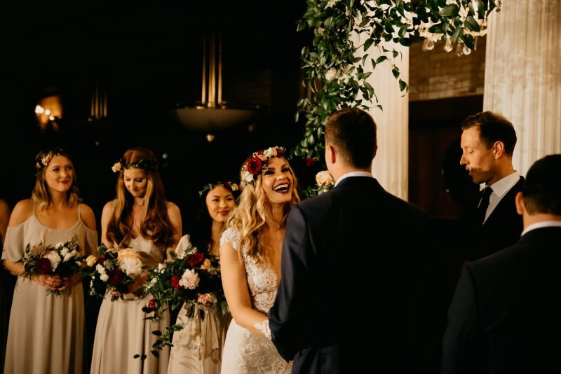 bridal party at the front of the alter
