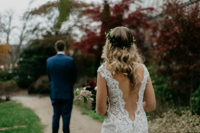 woman in a wedding dress approaching a man in a suit