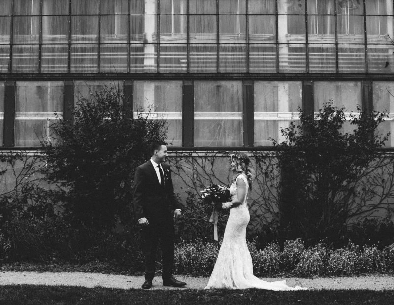 black and white photo of a woman in a wedding dress and a man in a suit