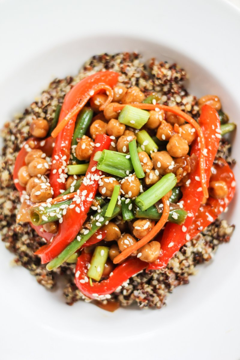 red peppers, green onions and chickpeas on top of quinoa in a bowl