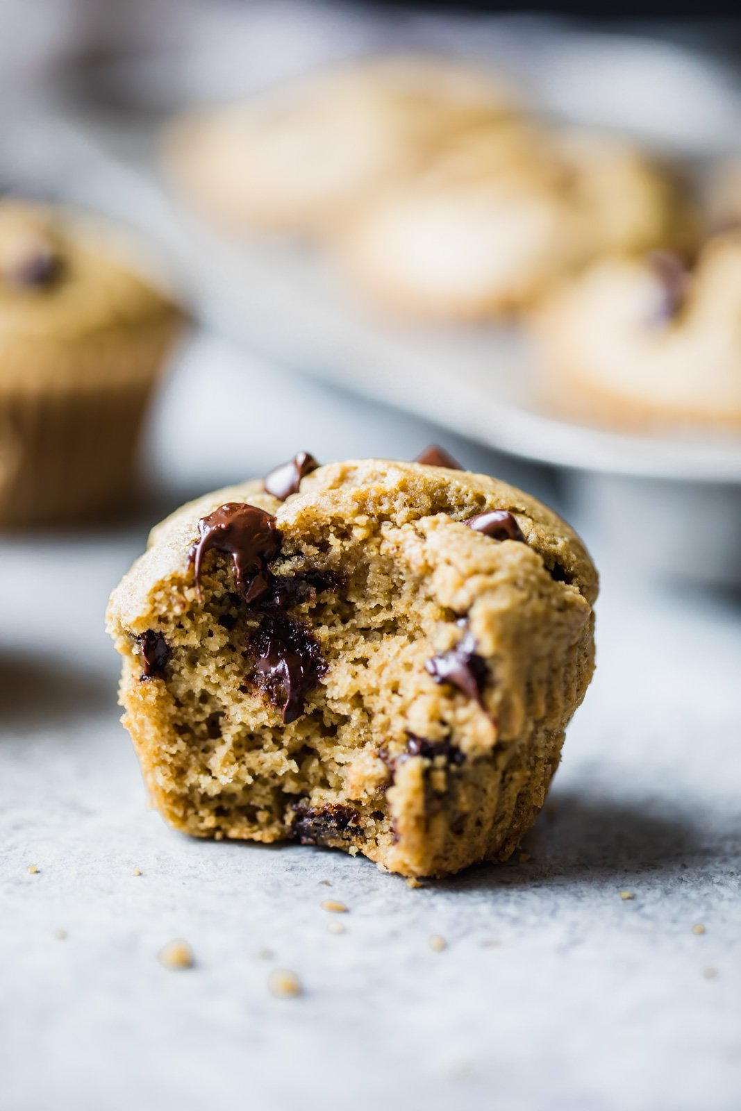 chocolate chip muffin with a bite out of it