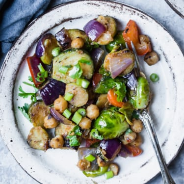 brussels sprouts stir fry with chickpea on a plate