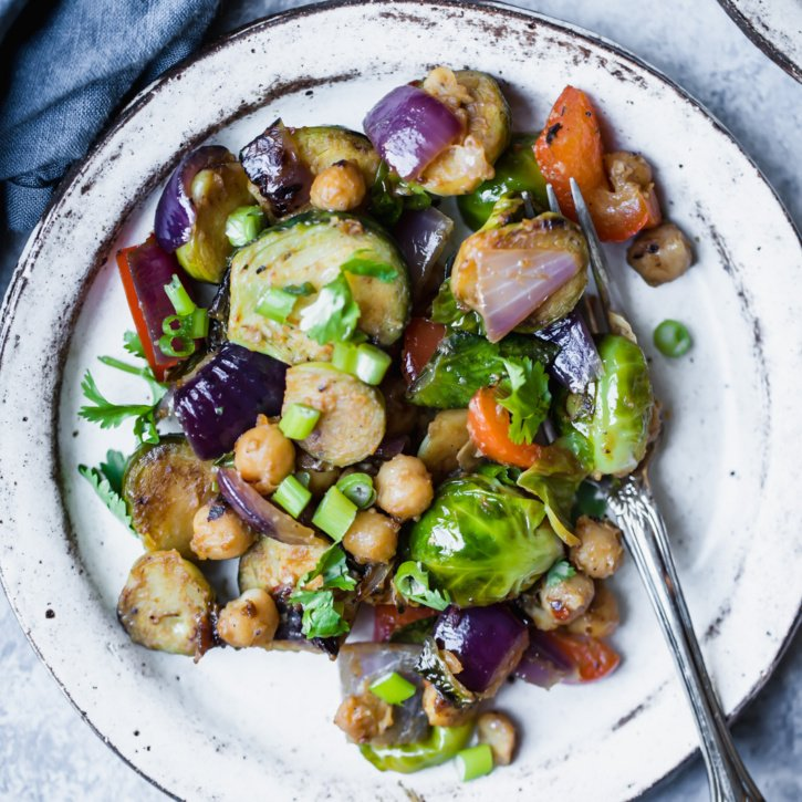 Vegan and gluten free kung pao chickpea & brussels sprouts stir fry made in one pan with a delicious homemade sauce and plenty of protein. This vegetarian dish is perfect for meal-prep!