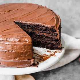 paleo chocolate cake on a cake stand