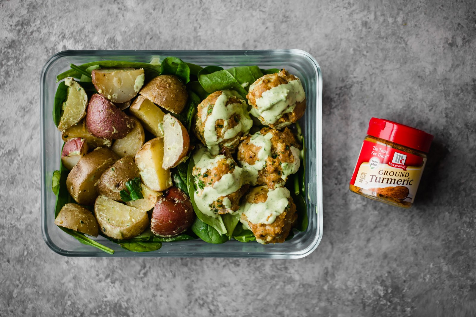turmeric chicken meatballs with potatoes in a meal prep container