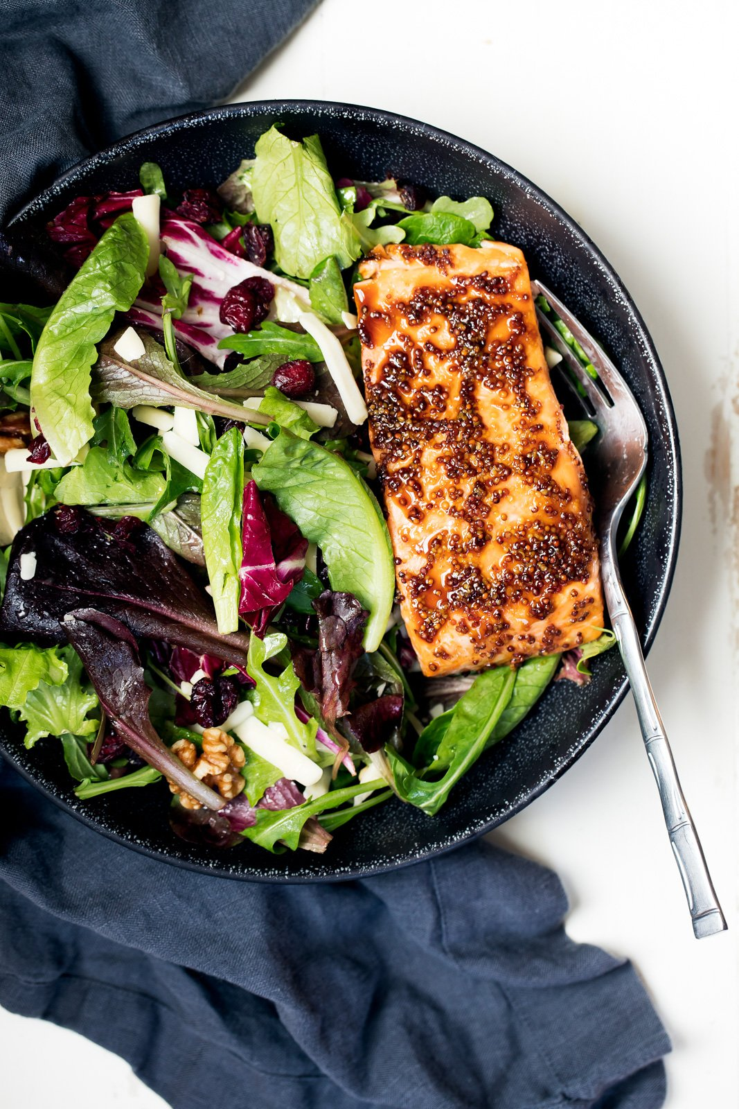healthy salmon recipes: salmon salad in a bowl with a fork