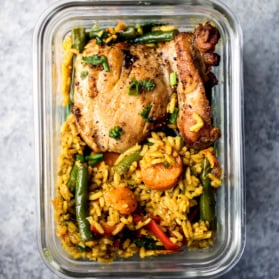 chicken veggies and rice in a meal prep container