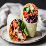 thai peanut chicken wraps on a plate