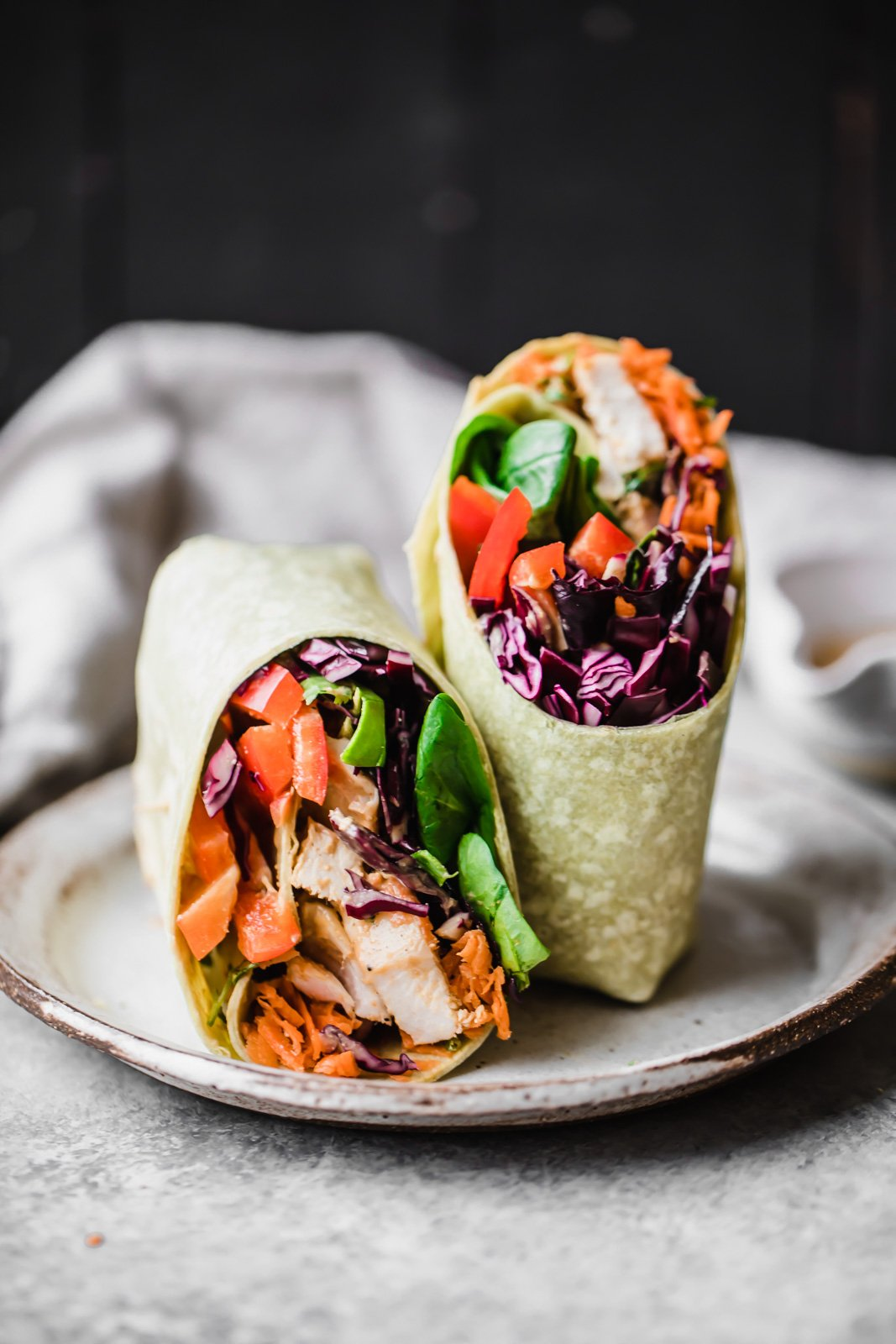 Bright, fresh crunchy rainbow Thai Peanut Chicken Wraps make the perfect lunch! They're veggie and protein-packed with a delicious peanut dressing for drizzling and dipping.